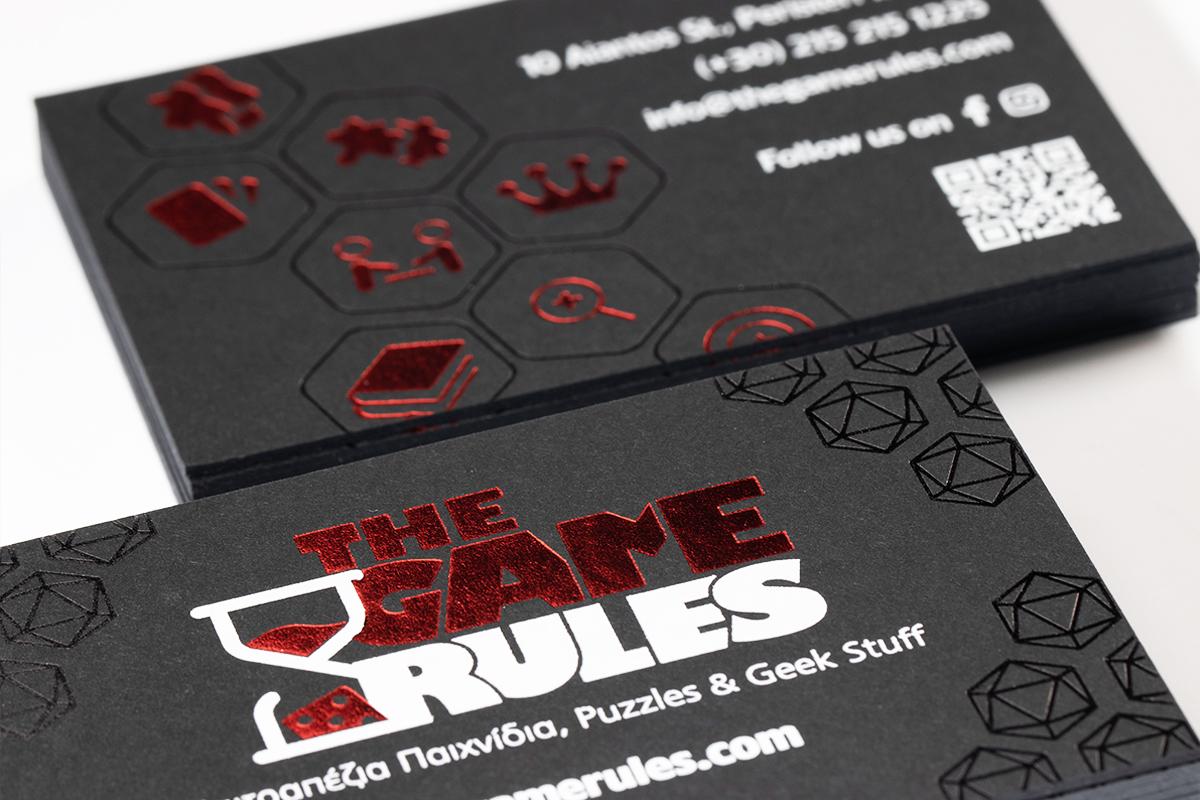 """Επαγγελματικές κάρτες τυπωμένες σε ειδικό χαρτί με τρία διαφορετικά χρώματα θερμοτυπίας, κατασκευασμένες για το κατάστημα """"The Game Rules"""" από την εταιρεία Καρτομάνια ΕΠΕ."""
